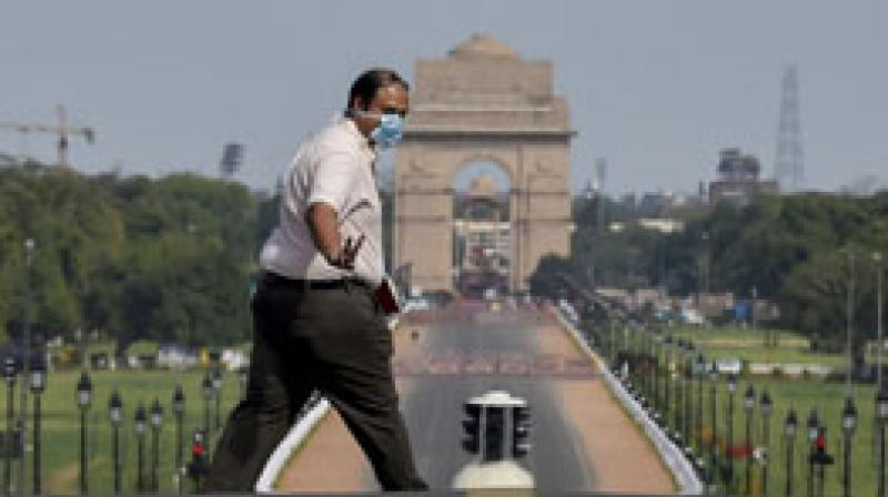 A man, wearing face mask walks at Raisina hill during the complete lockdown imposed to contain the spread of novel coronavirus, in New Delhi. PTI photo