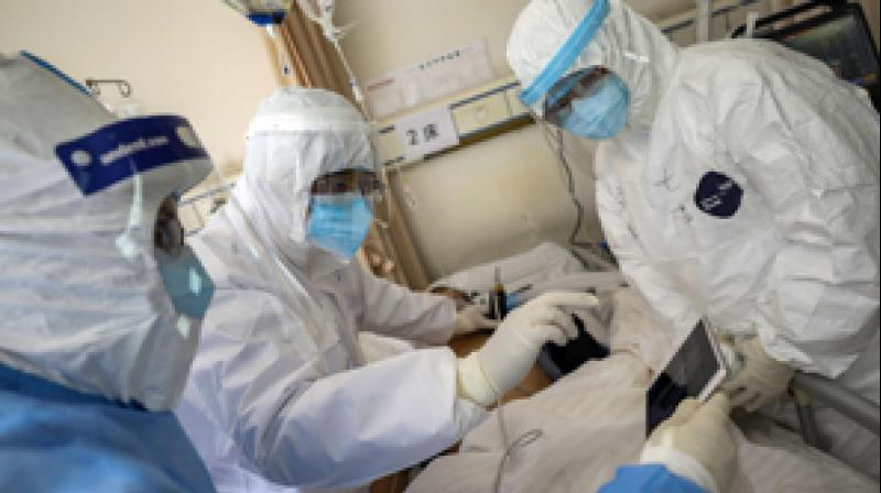Medical personnel scan a new coronavirus patient at a hospital in Wuhan in central China's Hubei province. AFP photo