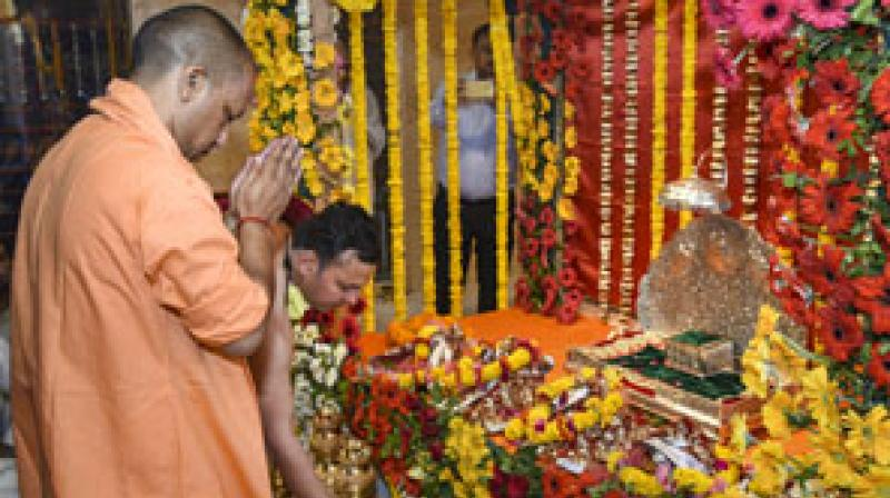 UP Chief Minister Yogi Adityanath offers prayers to Ram Lalla idol at temporary new location near Manas Bhawan, in Ayodhya. PTI photo