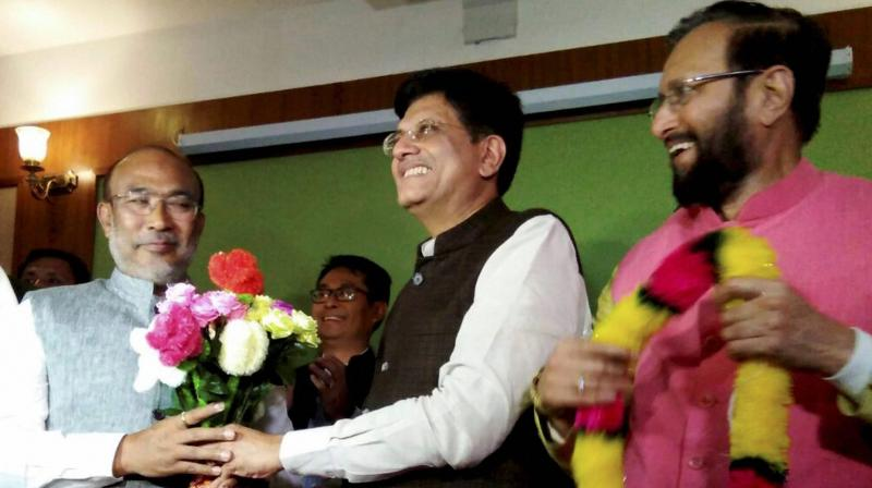 Nongthombam Biren Singh is greeted by Union Power Minister and BJP observer Piyush Goyal after he was elected at BJP legislature party leader in Imphal on Monday. HRD Minister Prakash Javadekar is also seen. (Photo: PTI)