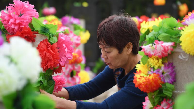 During the festival, people make offerings to honour their departed loved ones and keep them comfortable in the afterlife. (Photo: AFP)