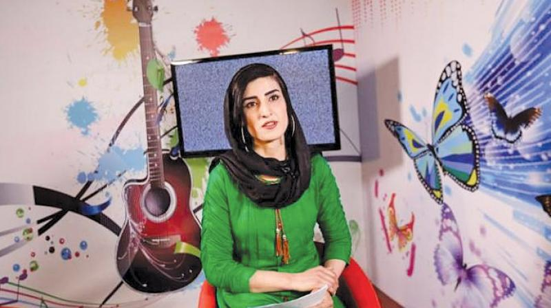 Krishma Naz, 22, presenter of a music show, sits during recording at the station. Zan TV launches on Sunday with a staff of all female presenters.