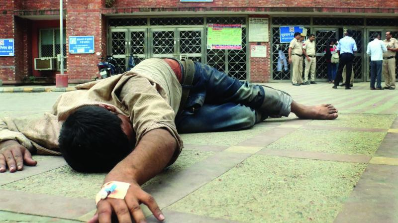 A patient lying unattended outside Lok Nayak Hospital in New Delhi on Friday. (Photo: Asian Age)