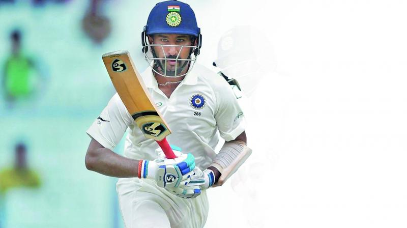 India batsman Cheteshwar Pujara in action during the second day of the first Test against Sri Lanka at Eden Gardens in Kolkata. (Photo: PTI)