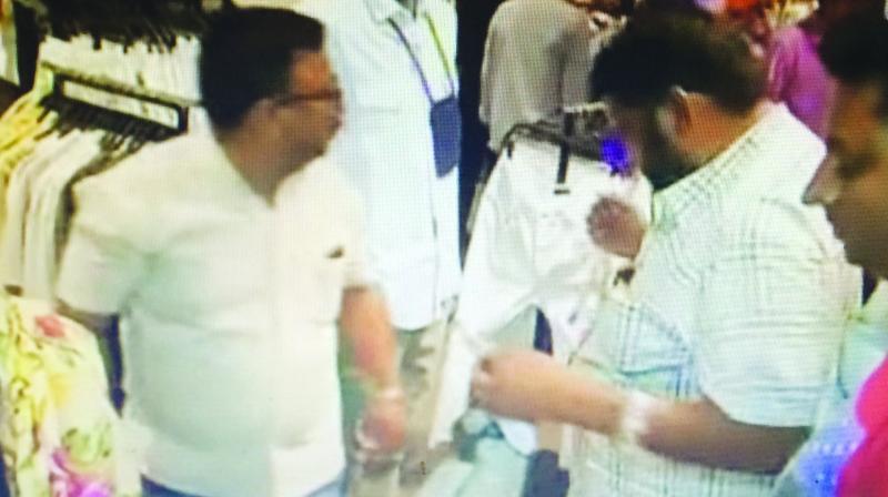 A video grab of MNS men trampling clothes at ZARA.