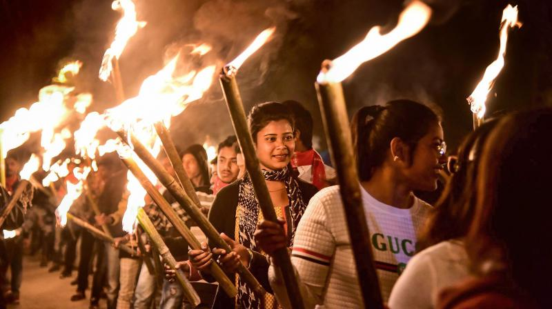 Activists of the All Assam Students Union take part in a torch rally to protest against the new citizenship law in Nagaon district of Assam, on February 8, 2020. The state has been witnessing protests over the National Register of Citizens and the Citizenship Amendment Act which require documentation to establish one's claim for citizenship. (PTI Photo)