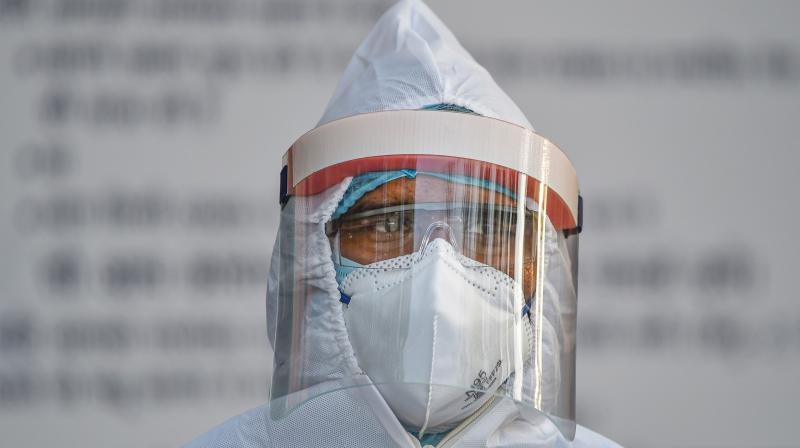 A medics wearing protective suit is seen at LNJP hospital during the nationwide lockdown, in wake of the coronavirus pandemic, in New Delhi. PTI photo
