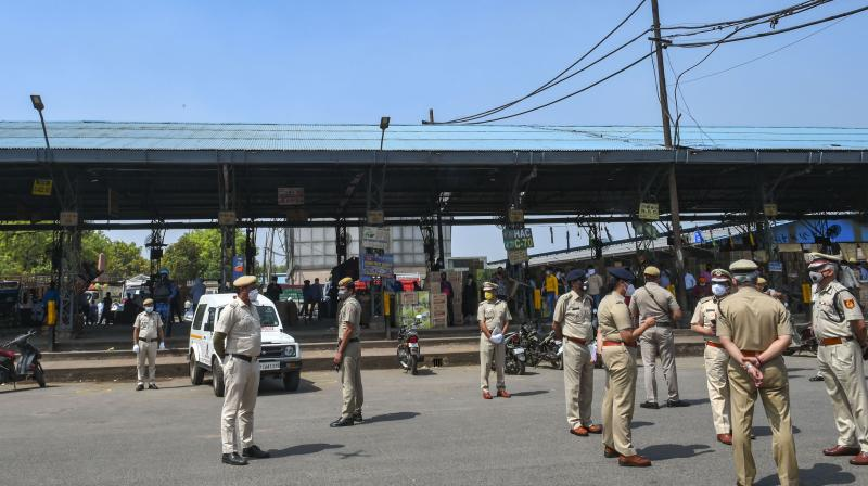 Delhi police commissioner SN Shrivatsav along with others inspect Azadpur subzi mandi in Delhi. PTI photo