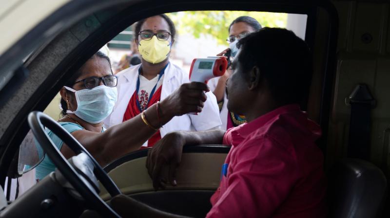 Health officials screen a driver for coronavirus symptoms on the Tamil Nadu-Andhra Pradesh on March 24, 2020. (AFP)