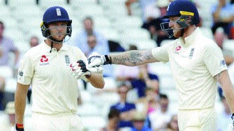 England's Ben Stokes (right) greets teammate Jos Buttler on the fourth day of their third Test at Trent Bridge in Nottingham, England, on Tuesday. (Photo: AP)