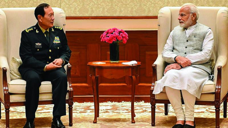 Prime Minister Narendra Modi and Chinese defence minister General Wei Fenghe in New Delhi on Tuesday. (Photo: PTI)