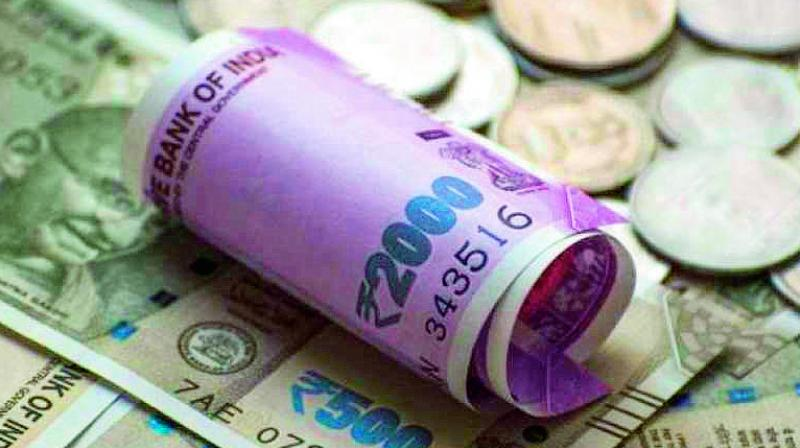 The rupee on Thursday slid further by 15 paise to close at a fresh lifetime low of 70.74 to the dollar due to month-end demand for the US currency from importers and rising crude oil prices.