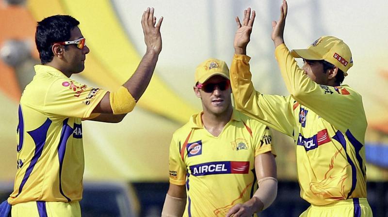 Ravichandran Ashwin of Chennai Super Kings celebrates a Rajasthan Royals' wicket with teammate Ajinkya Rahane. PTI Photo