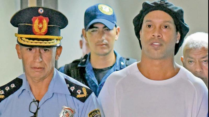 Former Brazilian star Ronaldinho being taken to the Paraguay's attorney offices in Asuncion, Paraguay. AP Photo