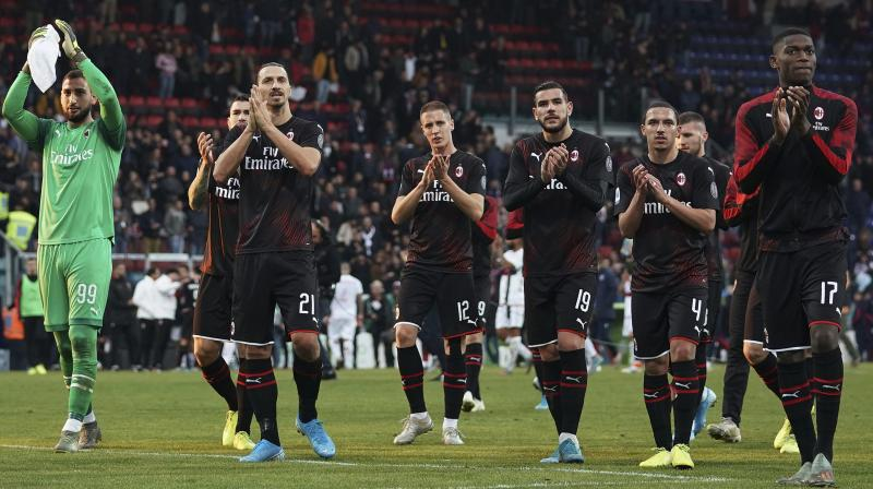 AC Milan players applaude their fans after winning their Italian Serie A match against Cagliari 2-0. AP Photo