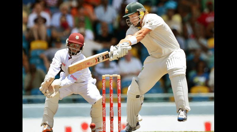 Australian cricketer Shane Watson plays a shot as West Indies wicketkeeper Carlton Baugh looks at the Kensington Oval stadium in Bridgetown. AFP Photo