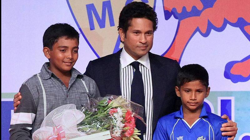 Sachin Tendulkar felicitating young cricketers Prithvi Shaw and Musheer Khan at a Mumbai Cricket Association function seven years ago (2013).  PTI Photo