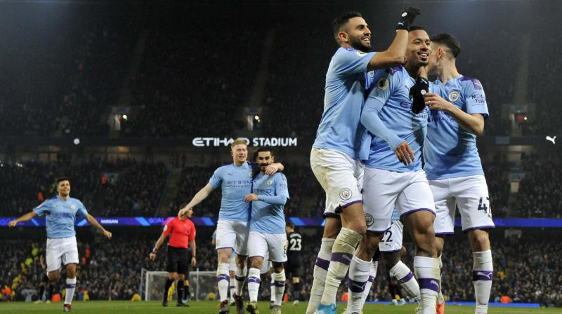 Manchester City's Gabriel Jesus (2nd R) celebrates with teammates after scoring against Everton at Etihad stadium in Manchester, England. AP Photo