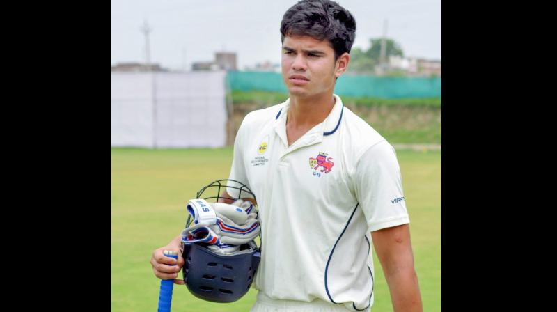 Arjun Tendulkar after playing in a local league match. PTI Photo
