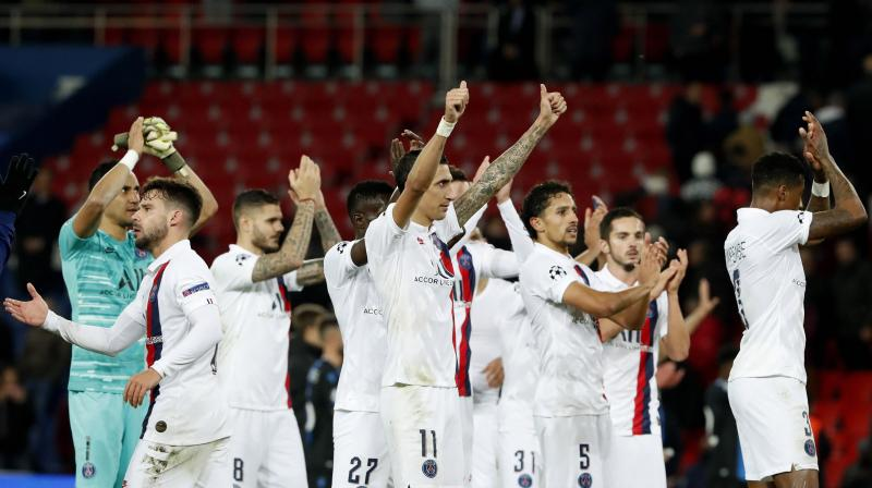 PSG players wave to their supporters after winning their Champions League Group A match against Brugge at the Parc des Princes stadium, in Paris. AP Photo
