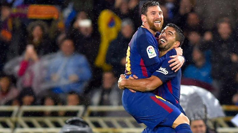 Barcelona duo Lionel Messi and Luis Suarez celebrate a goal. DC File Photo.
