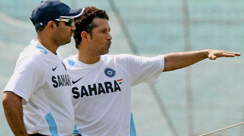 Sachin Tendulkar with Virender Sehwag during a practice session at Eden Garden in Kolkata. PTI Photo