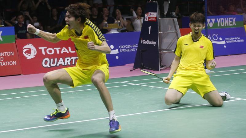 China's Li Junhui (L) and Liu Yuchen react after winning their 2018 Thomas Cup finals match in Bangkok, Thailand. AP Photo