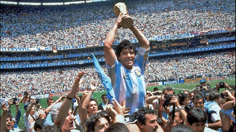 In this file photo, Diego Maradona of Argentina celebrates with the cup at the end of the 1986 Mexico World Cup in the Atzeca Stadium, in Mexico City, Mexico. Argentina defeated West Germany 3-2 to take the trophy. The English will never forgive him for his 'Hand of God' goal en route to winning the World Cup. AP Photo
