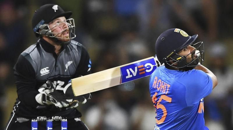 Rohit Sharma hits a six during the Twenty/20 international against New Zealand at Bay Oval in Mt Maunganui, New Zealand. AP Photo