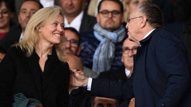 Lyon's President Jean-Michel Aulas (R) exchanges pleasantries with the president of the French Ligue LFP Nathalie Boy de la Tour before the match between Paris Saint-Germain (PSG) and Olympique de Lyon (OL) at the Parc des Princes stadium in Paris. AFP Photo