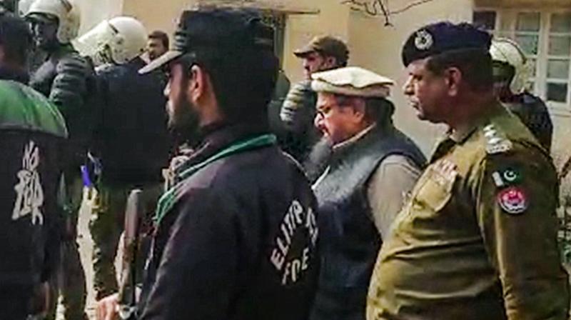 Mumbai attack mastermind and Jamat-ud-Dawa chief Hafiz Saeed at a court, in Lahore. PTI photo