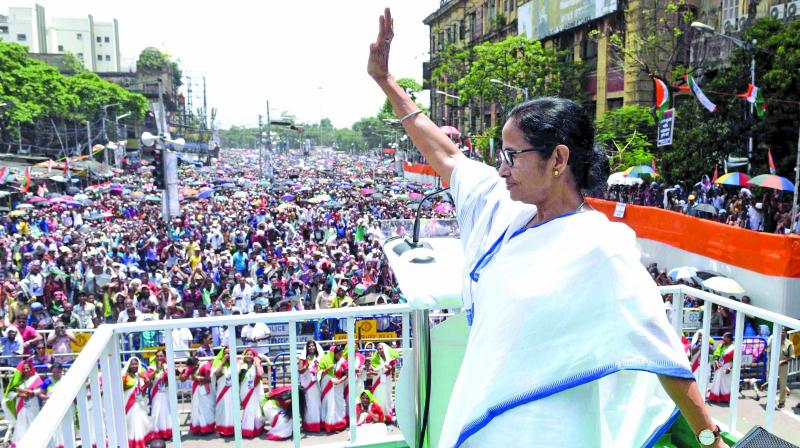 Chief minister and Trinamul Congress chief Mamata Banerjee greets supporters on Martyrs' Day programme at Esplanade on Sunday. (Photo: Asian Age)