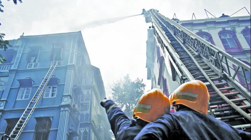 Firefighters attempt to douse the blaze at Churchill Chamber in south Mumbai. (Photo: Debasish Dey)