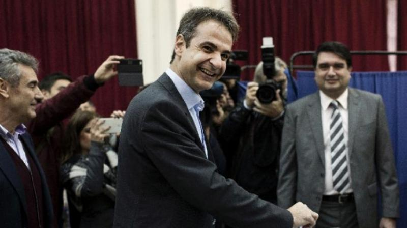 """""""A painful cycle has closed,"""" Mitsotakis said in a televised address, adding that Greece would 'proudly raise its head again' on his watch. (Photo: AFP I File)"""