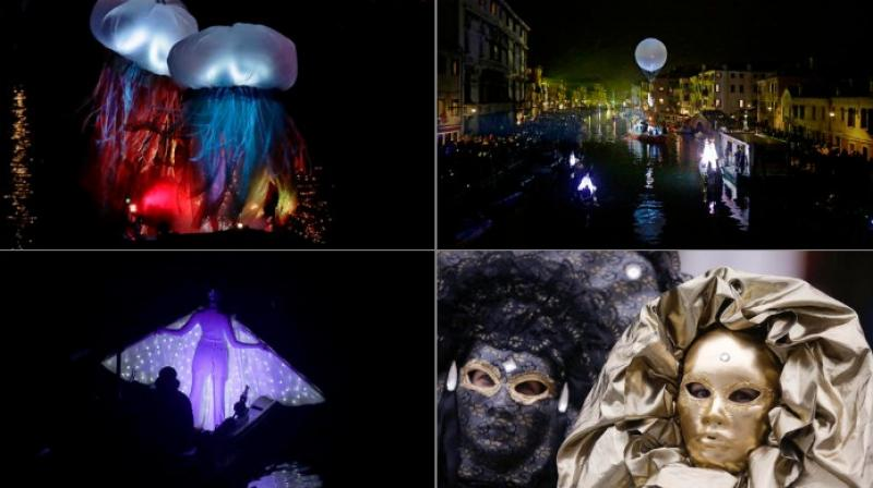 The canal in Venice was filled with boaths and people in bright costumes that made it look like a scene out of a fantasy (Photo: AP)