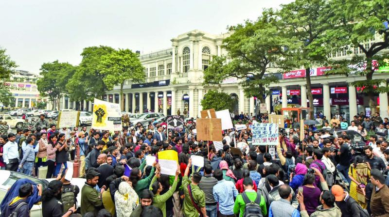 Students of Jawaharlal Nehru University and other educational institutions raise slogans during a protest  at Connaught Place in New Delhi on Wednesday. (Photo: PTI)
