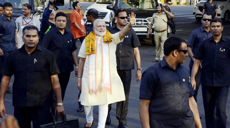 Prime Minister Narendra Modi waves to supporters at Bhubaneswar airport. (Photo: PTI)