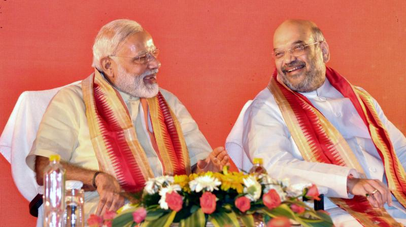 Prime Minister Narendra Modi with part president Amit Shah at BJP's National executive meet in Bhubaneswar. (Photo: PTI)