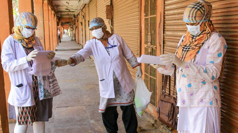 Medics submit their report after a door-to-door examination of COVID-19 during a nationwide lockdown imposed in the wake of coronavirus pandemic, in Jaipur. PTI photo