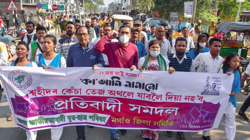 Members of Asom Jatiyatabadi Yuba Chatra Parishad (AJYCP) take part in a protest rally against the Citizenship Amendment Act (CAA), in Nagaon District of Assam, Friday, Dec. 11, 2020. (PTI)
