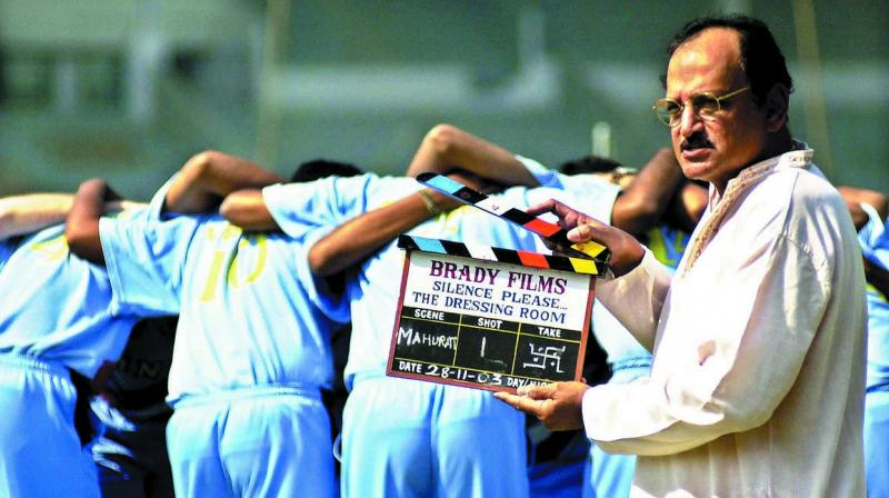 In this file photo taken on November 28, 2003, former India captain Ajit Wadekar (right) stands poised with a clapper board. (Photo: AFP)
