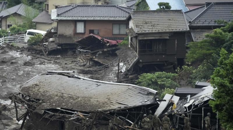 Japan Ground Self-Defense Force members search a mudslide area following heavy rains in Atami, Shizuoka Prefecture, west of Tokyo. (Photo: AP)
