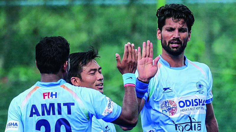 Indian players celebrate their 3-1 victory over New Zealand in Bengaluru on Saturday.