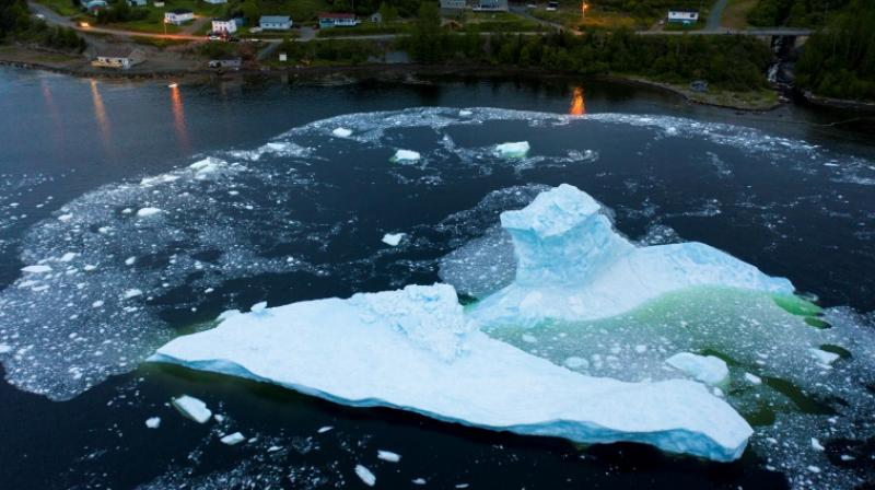 An iceberg collapses near Canada's east coast at King's Point in Newfoundland, which has a front row seat to the consequences of global warming. (Photo: AFP)