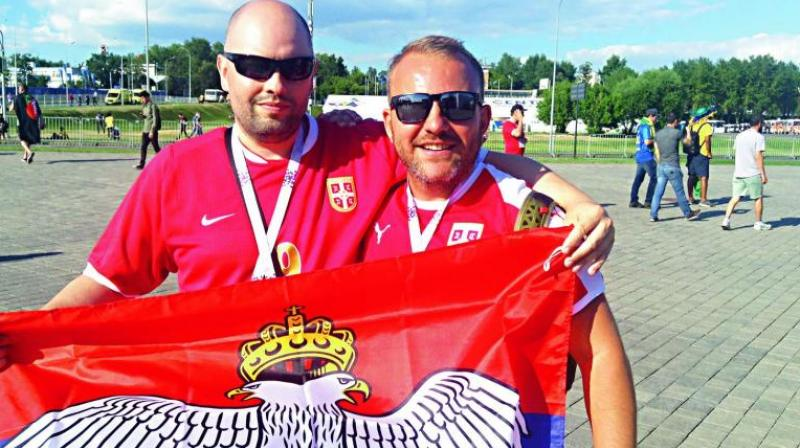 Serbian fan Goran Pentalic (left) with a compatriot ahead of the Brazil-Serbia match.