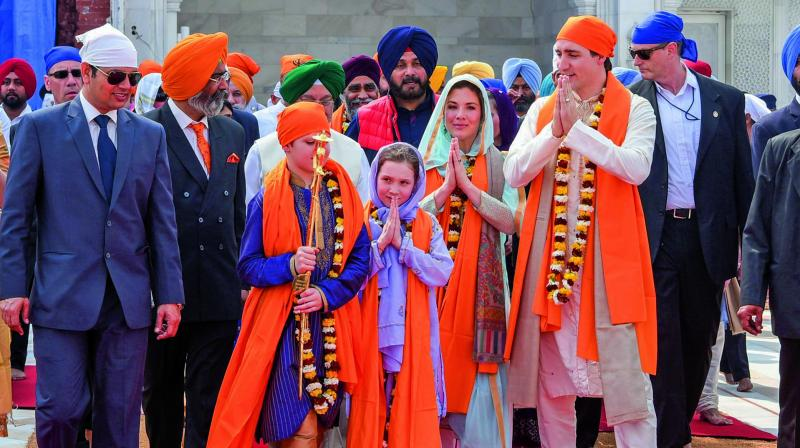 Canadian Prime Minister Justin Trudeau and his family members during their visit to the Golden Temple in Amritsar on Wednesday. (Photo: AP)