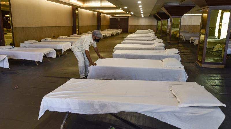 Beds being prepared at a Delhi isolation centre. (PTI)
