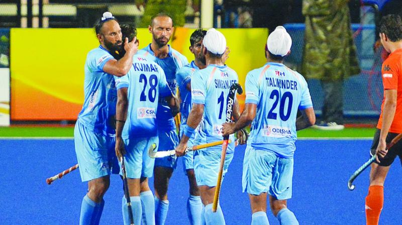 India skipper Sardar Singh celebrates with team mates after their 5-1 win over Malaysia in the Sultan Azlan Shah hockey tournament in Ipoh on Wednesday.