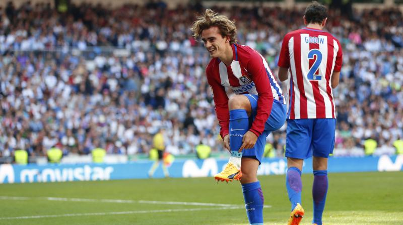 Antoine Griezmann used his left foot to drive home a perfectly placed through ball by substitute Angel Correa to equalise at the Santiago Bernabeu in the 85th minute. (Photo: AP)