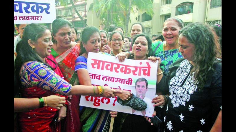 Bharatiya Janata Party (BJP) workers protest against Congress leader Rahul Gandhi on Sunday. (Photo: MRUGESH BANDIWADEKAR)